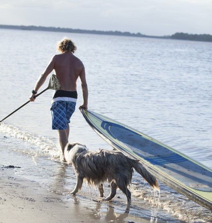 Chris de Aboitiz, Dog Trainer and Paddle Board instructor and Claire Dixon, Yoga Instructor